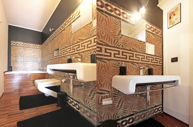 The bathroom is fitted with a particular tiles from the last century.