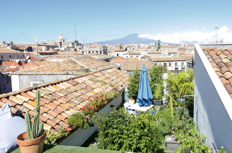 From the main bedroom there is another terrace garden overlooking Etna