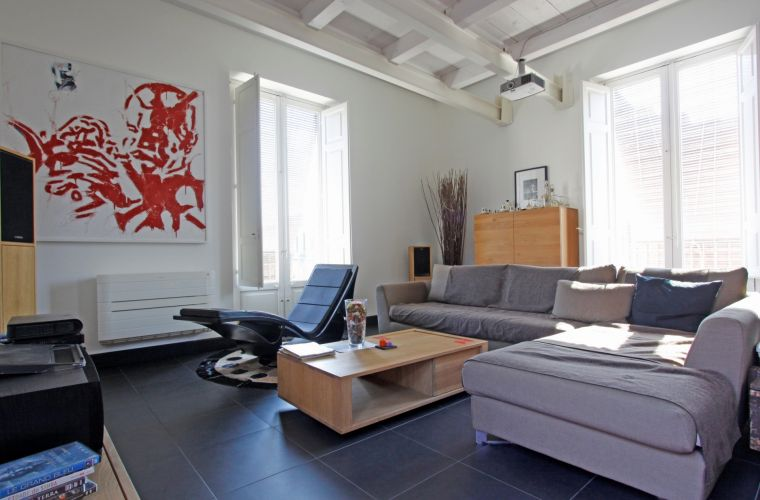 The apartment  is in contemporary style with furniture designed by the architect but you will find also some vintage original pieces from the last century.