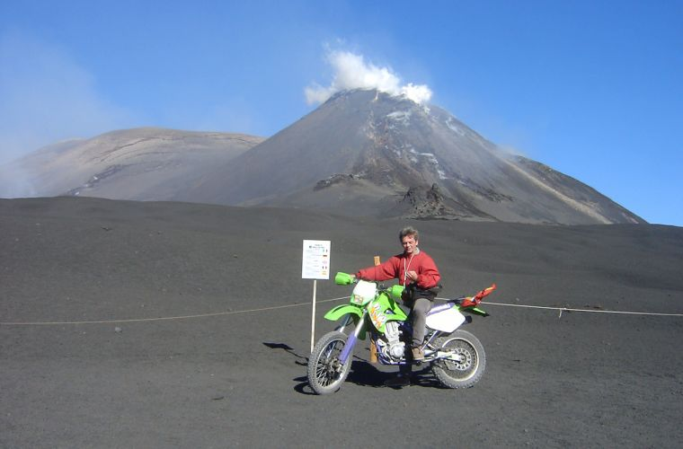 The writer Giovanni Vallone approaching the top with the motorcycle thanks to a special permission of Etna Park