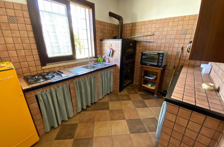 Traditional kitchen with wood-fired oven for excellent pizzas