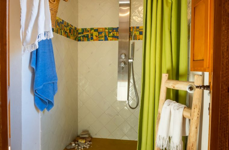 The second bathroom is en suite with rain shower massage, toilet and bidet.