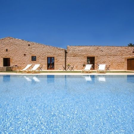 Pool and facade in typical Sicilian stone
