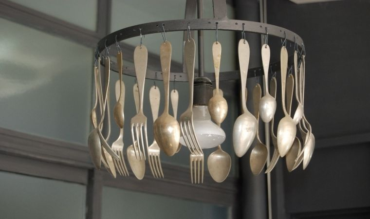 Cutleries as a chandelier in the kitchen
