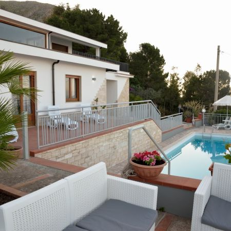The main entrance leads to the ground floor made up of two double bedrooms overlooking the pool area, and a  twin bedroom also with access to the terrace,  and a bathroom with shower.