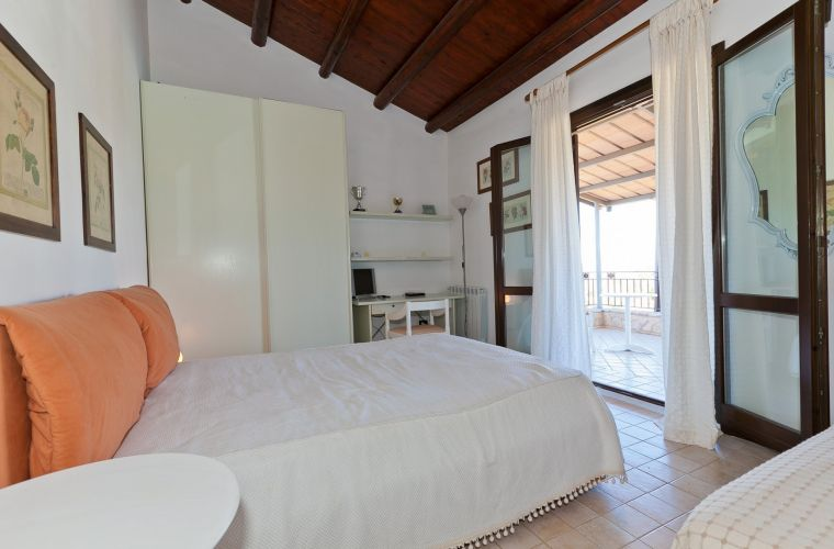 The remaining two bedrooms look out onto a beautiful covered terrace, overlooking the pool and the lush vegetation and they have a further bathroom with shower.