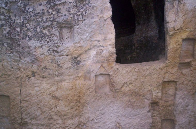 Niches where they had placed wooden and clay tablets on which were recorded the names of the Greek heroes