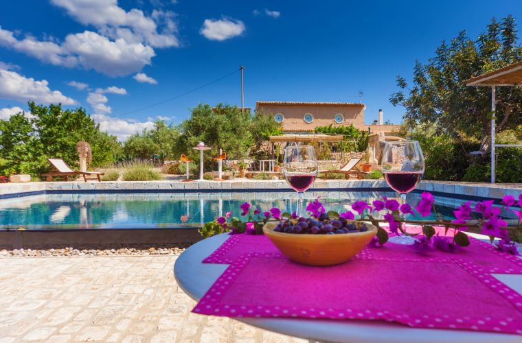 Sicilian red wine by the pool