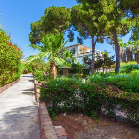 Entering the villa through a lush park