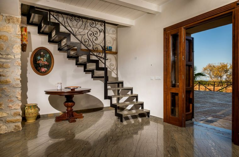 A comfortable staircase leads to the first floor with four bedrooms, all with wooden ceilings.