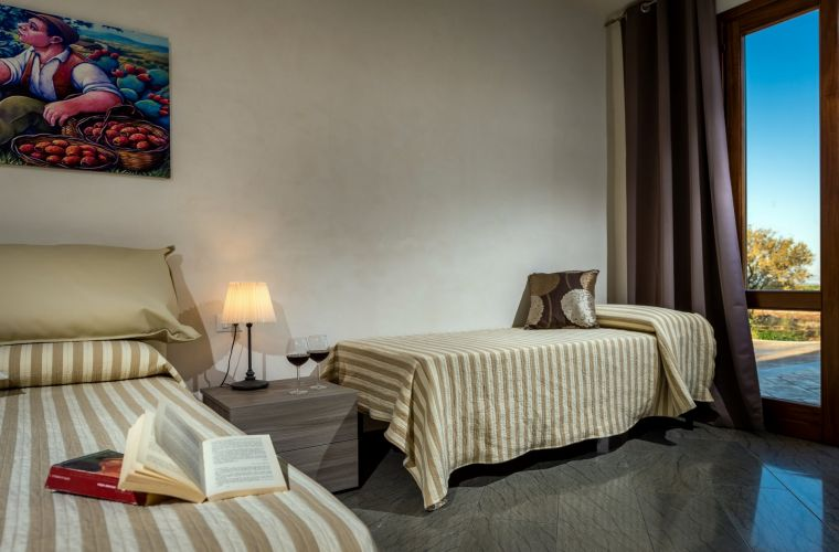 The fourth bedroom has a modern double bed, furnished with a comfort closed and a single bed
