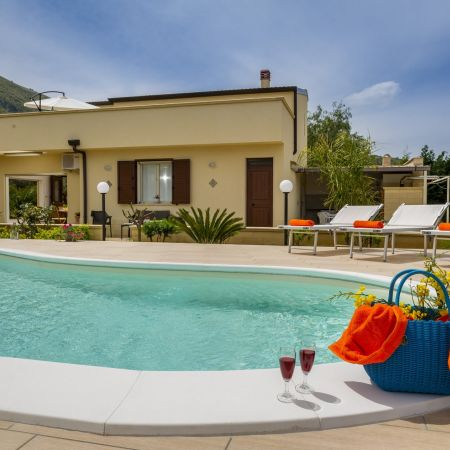 Facade, pool and the sun of Sicily