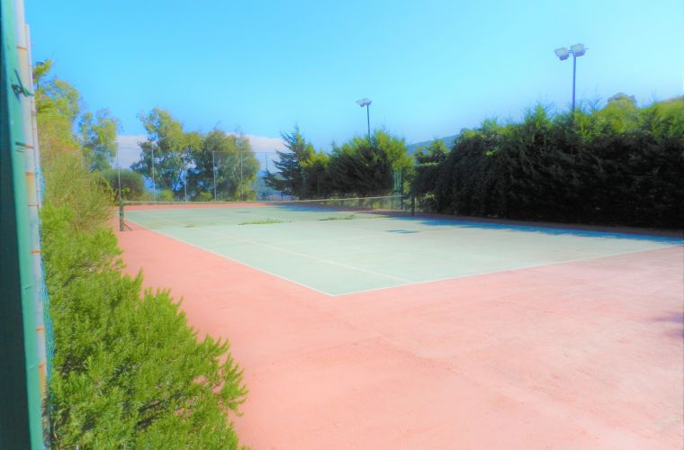Tennis court close by the pool