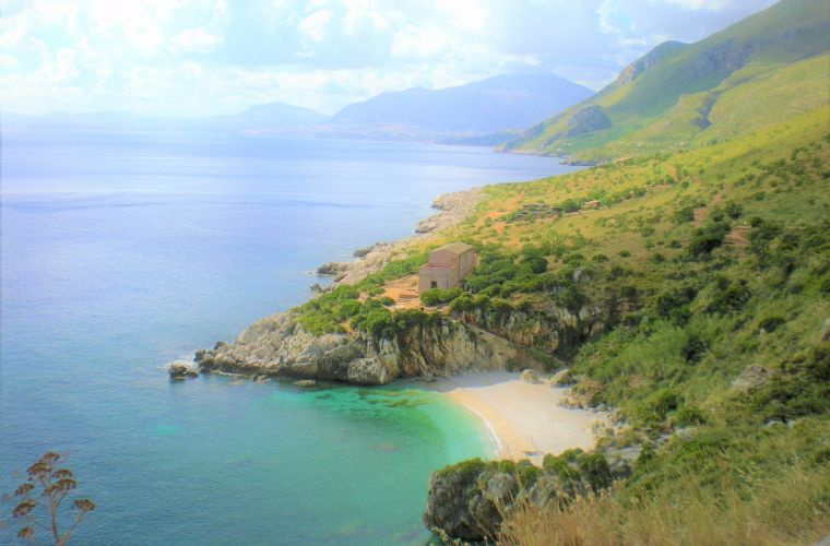 "Zingaro (50 km's) a natural reserve that has many ""calette"", corners of golden beaches, a sort of Paradise."