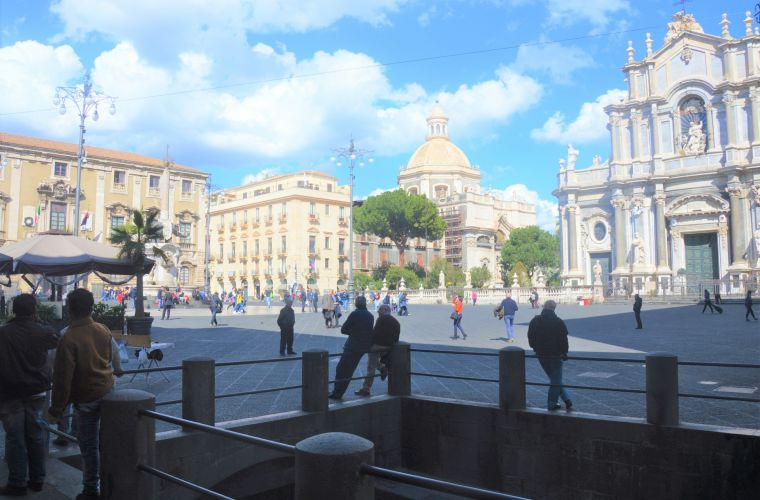 Catania  is 10 km's away. I suggest you to park the car in Piazza Alcalà than have a walk: let's start from the worldwide famous Pescheria (outdoor fish market), then to Piazza Duomo.
