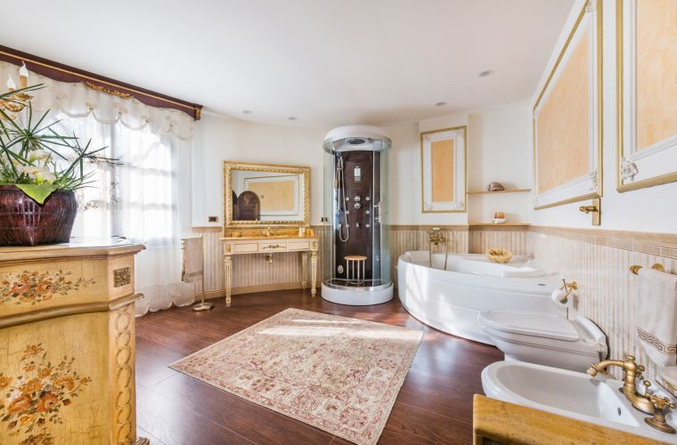 The big elegant bathroom has a tub.