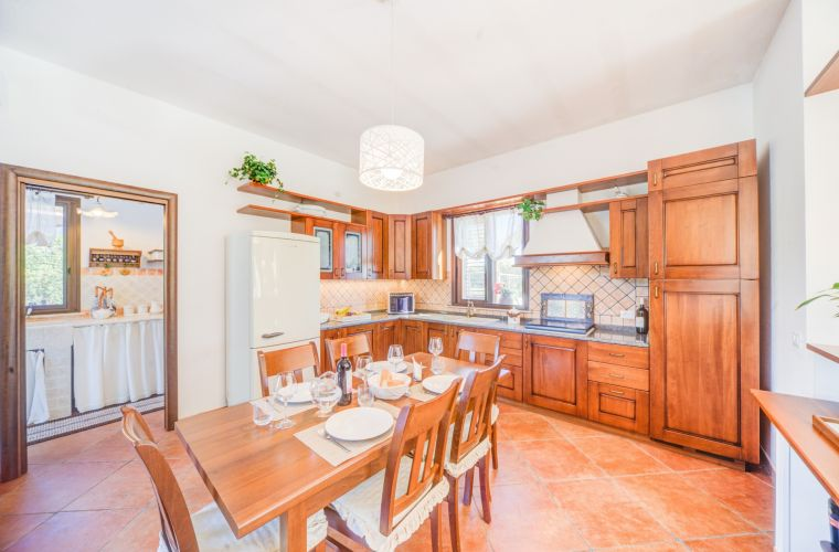 A big kitchen awaits you and has all the utilities you could need during your stay in this beautiful villa.