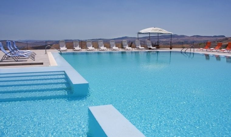 The biggest pool in Sicily and the grain fields on the background