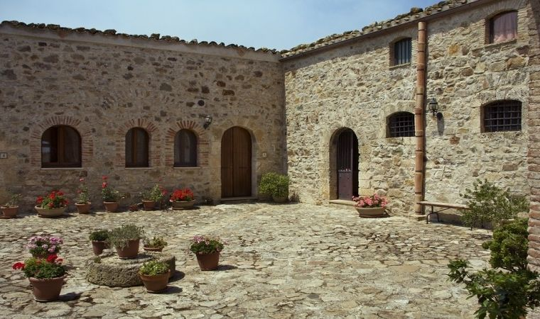 All the bedrooms face the historical courtyard