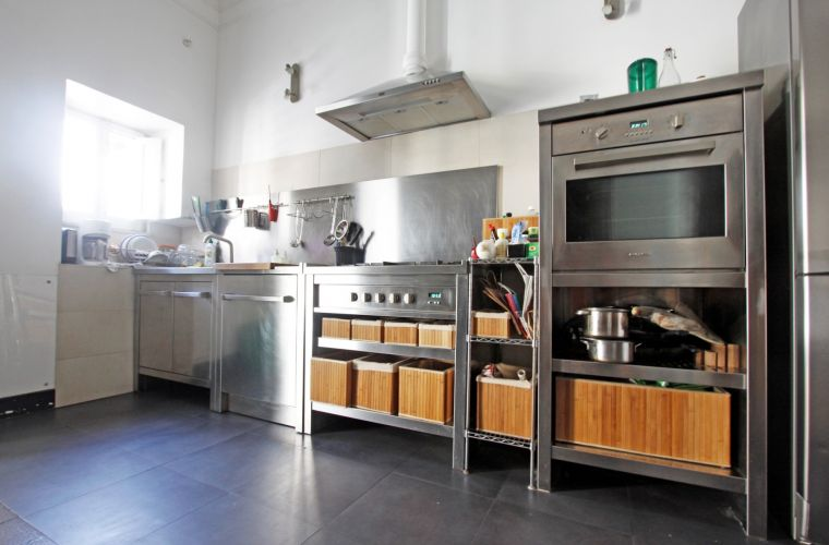 A professional kitchen (industrial stile) made of brushed steel of high quality